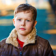 Homeless sad blond abandoned alone child is boy on street in jac — Stock Photo