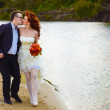 Newly married couple are on beach at river, bride and groom are  — Stock Photo