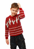 Blonde boy in a red sweater scratching his head thinking isolate — Stock Photo