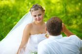 Bride, blonde woman groom wedding couples woman on a green back — Stock Photo