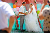 Bride blonde and groom newlyweds are on register ceremony conten — Stock Photo