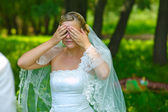 Bride woman has closed eyes with his hands for a surprise, myste — Stock Photo