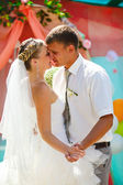 Couple bride and groom kissing newlyweds on day dance wedding r — Stock Photo