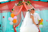 Couple bride blonde and groom kissing on the wedding day dance — Stock Photo