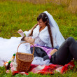 Bride and groom picnic in yellow autumn forest in a romantic set — Stock Photo #16210133
