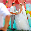 Bride blonde and groom during newlyweds wedding registration cer - Stockfoto
