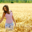 Royalty-Free Stock Photo: Woman in field with wheat