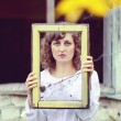 Young european woman girl in white dress holding frame window wi — Stock Photo