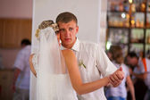 Bride and groom dancing at wedding couple, sad crying in hall — Stock Photo