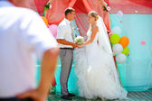Bride blonde and groom during newlyweds wedding registration cer — Stock Photo