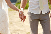 Couple holding hands — Stock Photo
