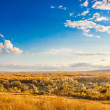 Russian landscape autumn hills and village below clouds, Russia - Stock Photo
