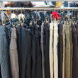 Stock Photo: Group different colored jeans hanging on a hanger in store