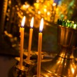 Stock Photo: Lighting candles in russian orthodox church