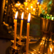 Lighting candles in russian orthodox church — Stock Photo