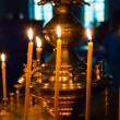 Stock Photo: Lighting fire candles in russiorthodox church