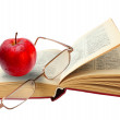 Open book and glasses red apple on a white background (clipping — Stock Photo