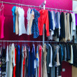 Stock Photo: Shop different with clothes shopping, racks and shelves with wom