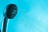 Fresh splash bath shower and current blue water — Stock Photo