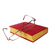 Glasses and a red book isolated on white background — Stock Photo