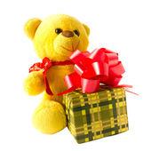 Pata de urso de pelúcia caixas isoladas de amarelo e presente — Fotografia Stock