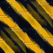 シームレスな黄色の黒のストライプの石の壁の壁紙 — ストック写真