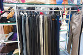 Shop pants different group colored jeans hanging on a hanger in — Stock Photo