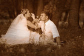 Retro black and white photo of sepia bride and groom at a weddin — Stock Photo