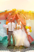Sunlight Bride blonde and groom during newlyweds wedding ceremon — Stock Photo