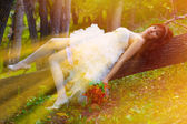 Sunlight Bride red haired woman in a white dress with sexy legs — Stock Photo