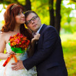 Newlyweds at wedding bride and groom are embracing green woo — Zdjęcie stockowe #24481457