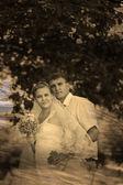 Retro sepia black and white photo bride groom newlyweds blonde s — Stock Photo