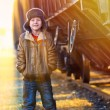 Stock Photo: Sunlight Boy homeless bum in brown jacket and fur hat and cr