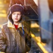 Sunlight Boy homeless bum on street freezing close to railway ca — Stock Photo