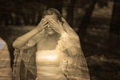 Retro sepia black and white photo, bride woman has closed eyes w — Stock Photo