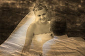 Retro sepia black and white photo, Bride looking at groom weddin — Stock Photo