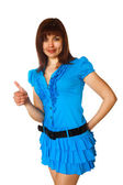 Beautiful young brunette woman showing thumbs up yes in the blue — Stock Photo