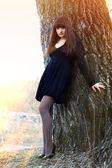 Brunette sunlight beldam witch girl black dress, — Stock Photo