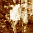 Retro sepia photo curly-haired girl with bare legs in a white sh — Stock Photo