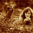 Retro sepia photo curly-haired girl woman in jeans and tshirt ly - Lizenzfreies Foto