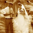 Retro sepia photo groom wears ring bride wedding couple newlywed - Stock Photo