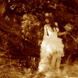 Retro sepia photo, lonely woman in white dress at wedding bride — Stock fotografie