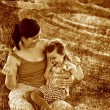 Retro sepia photo, mother, daughter, woman and child sitting gra - Foto de Stock