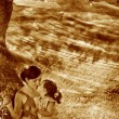 Retro sepia photo, mother, daughter, woman and child sitting gra - Stockfoto