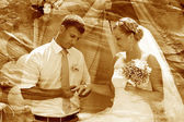 Retro sepia photo groom newlyweds wears ring bride wedding coupl — Stock Photo