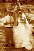Retro sepia photo groom wears ring bride wedding couple newlywed — Stock Photo
