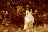 Retro sepia photo, lonely woman in white dress at wedding bride — Stock Photo