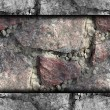 Red granite texture to edges of wallpaper — Stock Photo