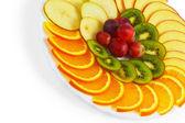 Plate apple kiwi grapes sliced food isolated on white background — Stock Photo