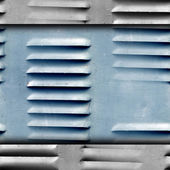 Grunge texture of old iron shutters ventilation wallpaper — Stock Photo